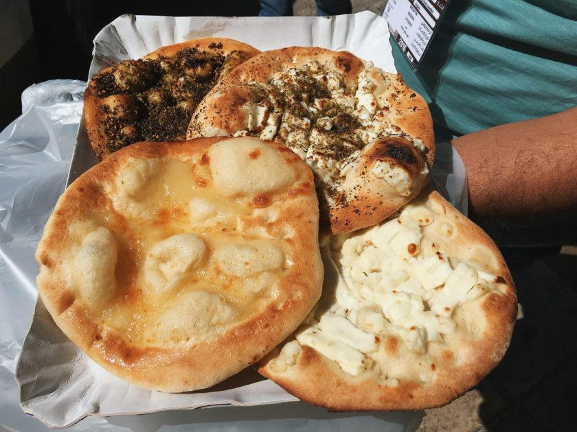 Manakish with various toppings such as Egg, Cheese and Za'atar