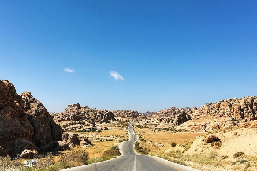 Long winding rocky road, on the way to Wadi Rum from Petra