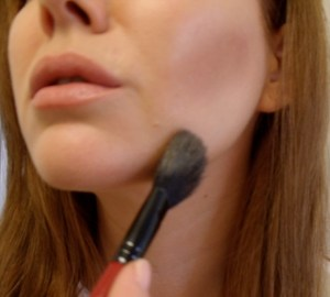 Brush excess bronzer under jawline and around temples.