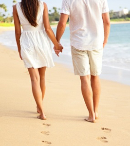 walking on beach hand in hand - girl gets great guy