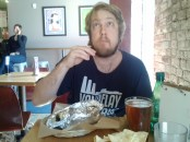 Boyfriend enjoying the chips and salsa and his burrito at Laughing Planet. He raved about his braised beef burrito.