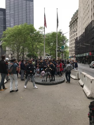 It's not easy to make out more than the Charging Bull's tail because of all of the tourists. You can see the back of the Fearless Girl facing him.