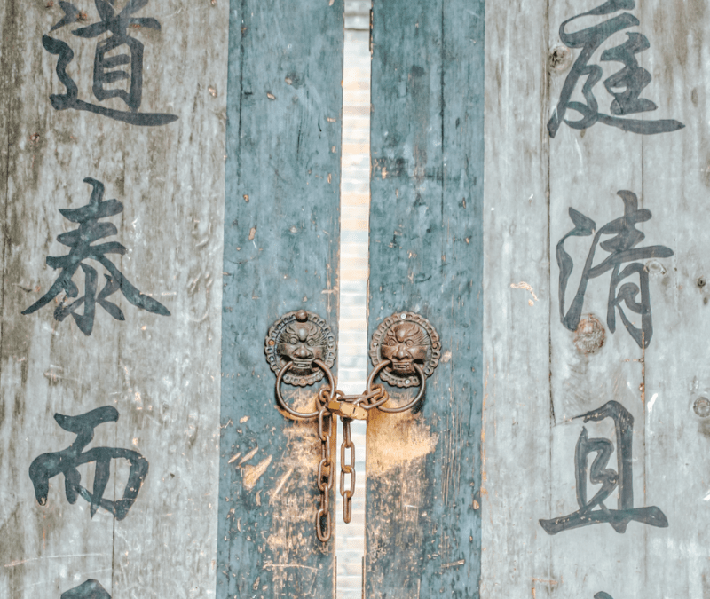 ancient door with traditional writing on it