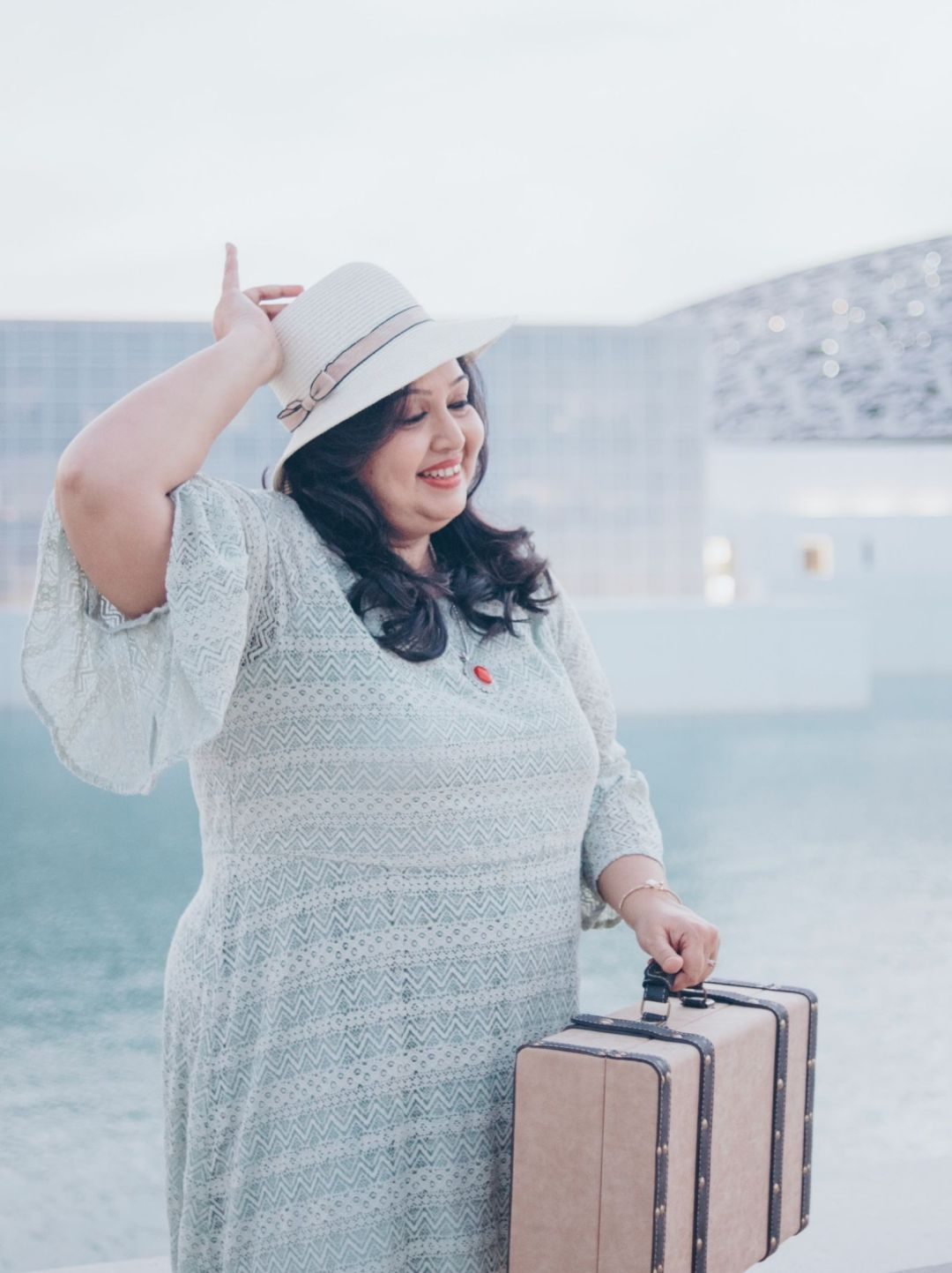 Solo woman traveller with a suitcase in Abu Dhabi