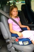 Girl in Booster Seat. Photo: Halton Parents