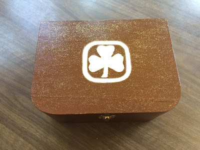 Brown-box-white-trefoil