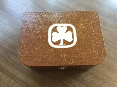 Brown-box-white-trefoil