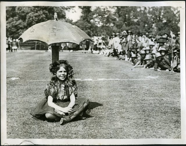 While there's no date or caption to provide specific information about this image, it is obvious that this girl member was participating in a special moment during her time in Guiding.