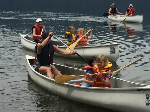 Girls canoeing at camp