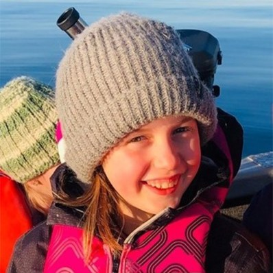 Charlee, a Guide from Campbell River, British Columbia outdoors in a hat