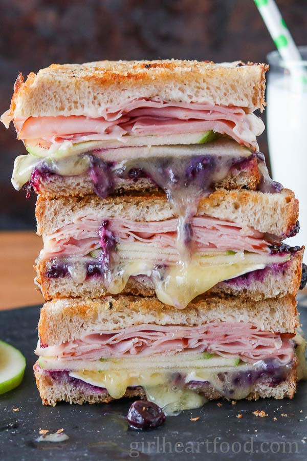 Stack of ham and brie cheese grilled cheese sandwich.