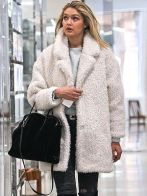 Is Gigi Hadid the queen of white winter fashion? Probably.