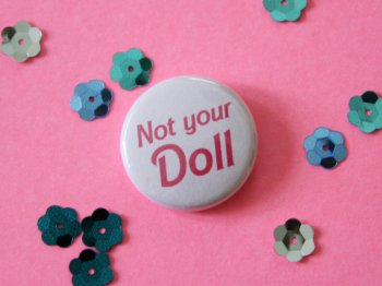 This Barbie-inspired pin is a fave of ours. Find it on ModernGirlBlitz's Etsy shop.