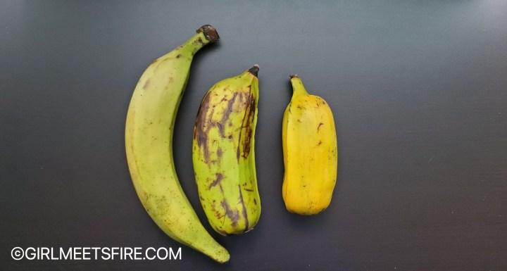 three plantains.  a long,standard plantain (green), a green Hawaiian plantain and a ripe Hawaiian plantain