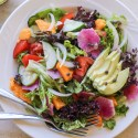 tropical green salad with papaya seed vinaigrette