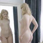 pale shaved teen blonde poses in the mirror