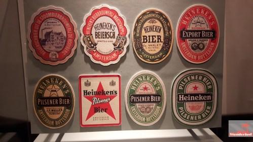 exploring-amsterdam-the-heineken-experience-brewery-tour-girlswanderlust-logos
