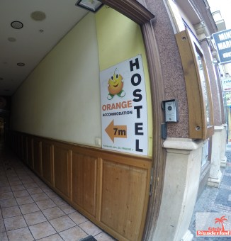 Hostel Orange Review Bad front sign.jpg