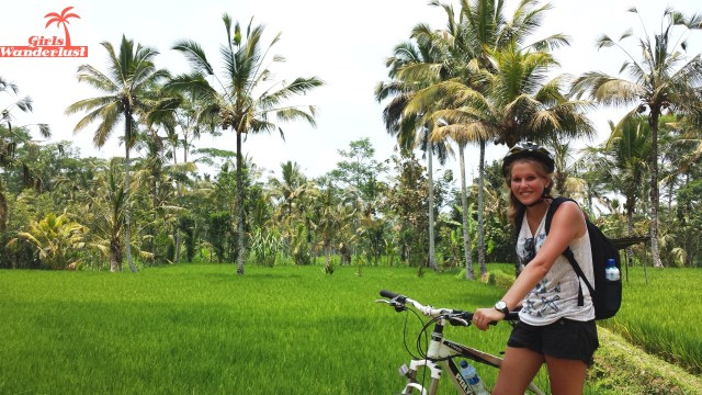 Cycling through rice paddy fields. The Bali Bucket List with 124 things to do! #girlswanderlust #Bali #Indonesia #wanderlust #travel
