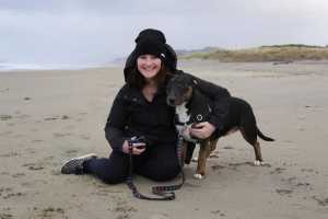 Girls Who Travel | Team Member Priscilla poses on the beach with her dog