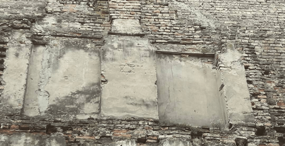 A Star of David etched into a wall in a Vilnius alleyway
