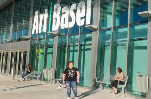 Ashley standing in front of the entrance to Art Basel Miami Beach 2019