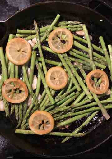 asparagus lemons garlic in cast iron skillet
