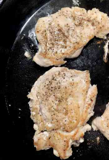 seared chicken breast in a cast iron skillet