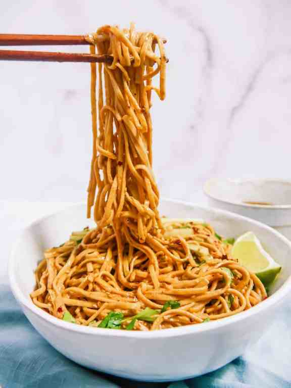 frontal photo of noodles being pulled up out of the bowl