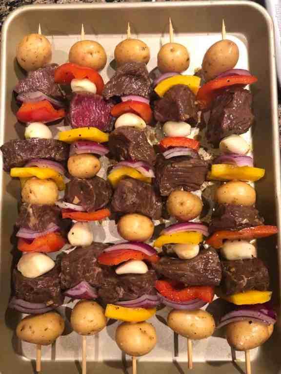 marinated steak skewers on bamboo skewers with vegetables pre grill