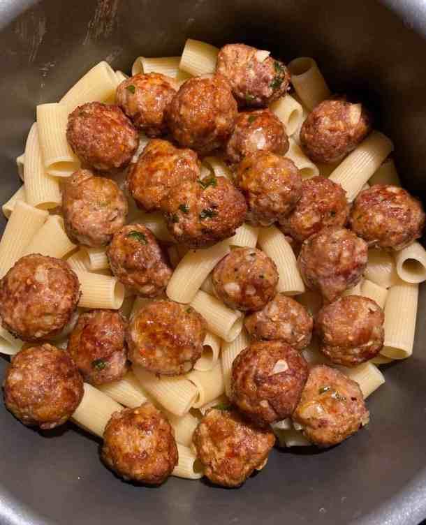 rigatoni pasta with meatballs on top