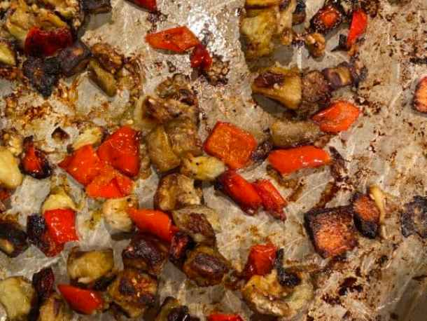 roasted eggplant and bell pepper on a baking sheet