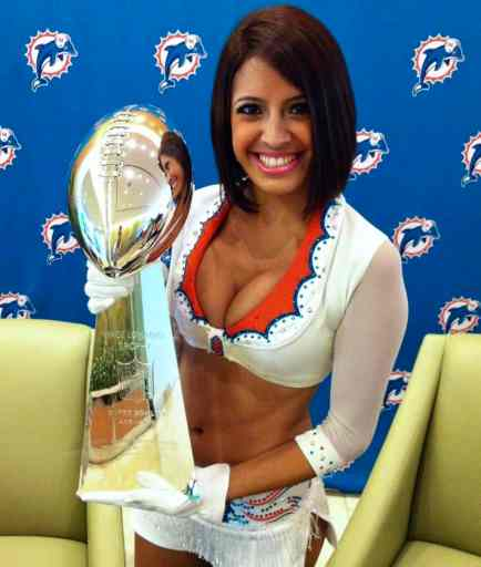 stephanie holding the miami dolphins lombardi trophy