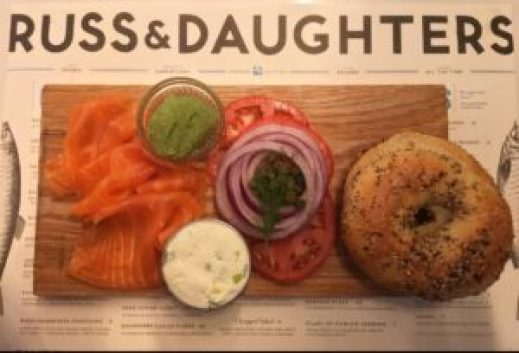 Russ and Daughters is home to the iconic, NYC brunch, which is a traditional NYC bagel with cream cheese, and lox.