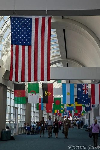 International flags hang in the hall of the San Diego Convention Center.