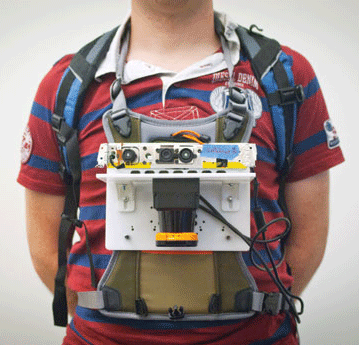 Maurice Fallon, researcher from MIT's Computer Science and Artificial Intelligence Laboratory, wears the portable mapping device.
