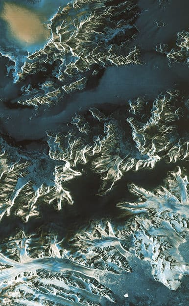 Acquired on 13 April 2014 at 23:57 GMT (14 April at 01:57 CEST) by Sentinel-1A, this image shows a transect over the northern part of the Antarctica Peninsula. It was acquired in the satellite's 'strip map' mode with a swath width of 80 km and in dual polarisation. The colours indicate how the land, ice and water reflect the radar signal differently. Source: ESA.