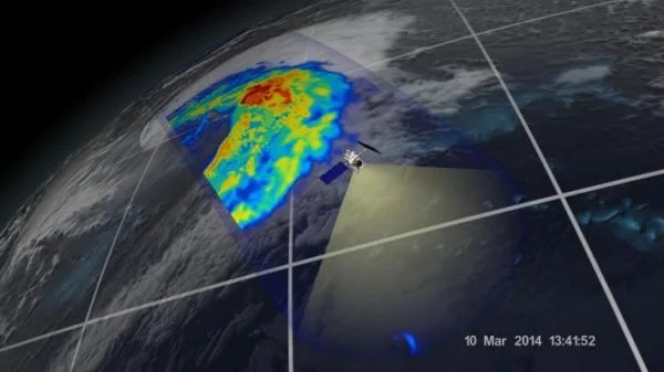 First Images from GPM Microwave Imager: The image shows rain rates across a 550-mile (885 kilometer) wide swath of an extra-tropical cyclone observed off the coast of Japan on March 10, 2014. Red areas indicate heavy rainfall, while yellow and blue indicate less intense rainfall. In the northwest part of the storm in the upper left of the image, the blue areas indicate falling snow.