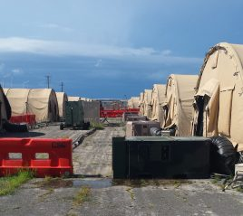 Backs of tents where NGOs live at Camp Justice.