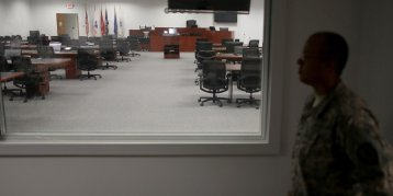 Guantanamo_courtroom_gallery - with guard