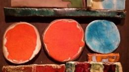 #Picture #Ceramic wall composition with #orange circles and #liquefied_clay pieces on a board. Cuadro, composición de cerámica para pared con círculos naranjas hechos con #cerámica_licuada sobre tablero.