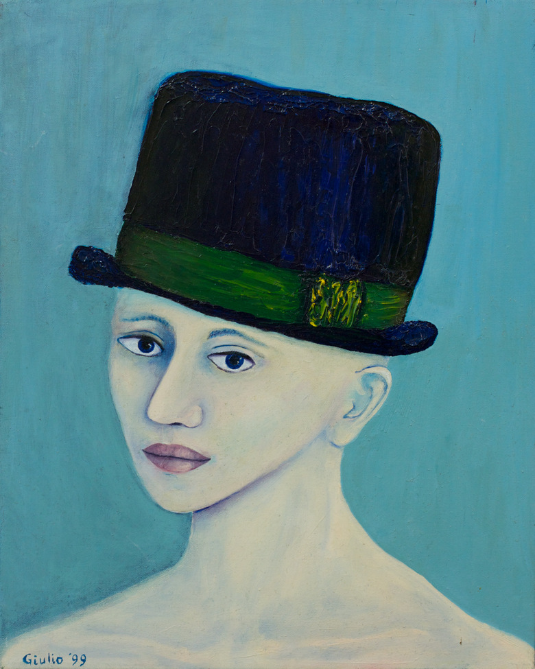Woman, bare shoulders, in blue hat. Blue background