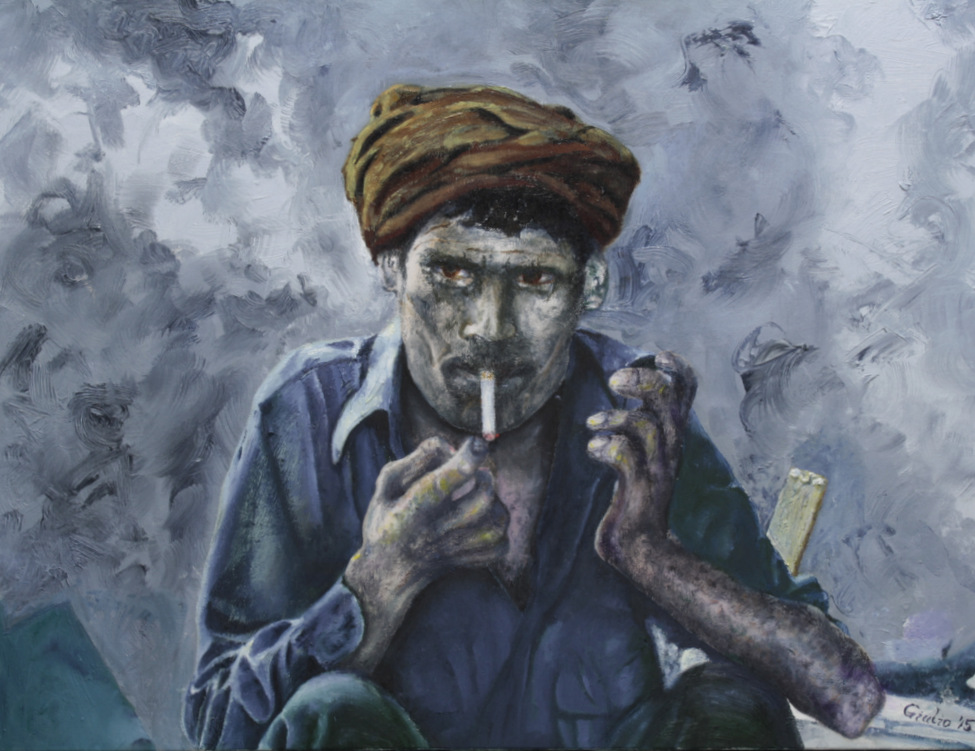 portrait of a factory worker lighting a cigarette in smoky environment