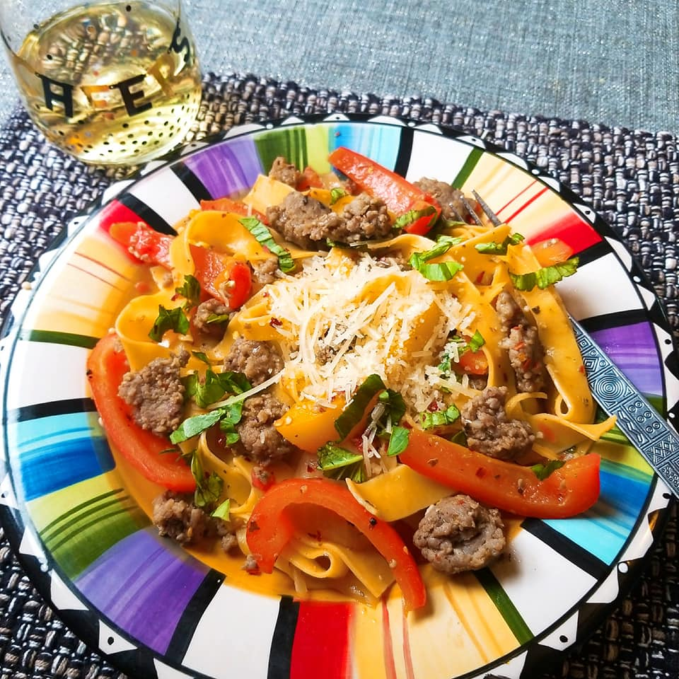 Italian Drunken Noodle with a glass of Chardonnay white wine