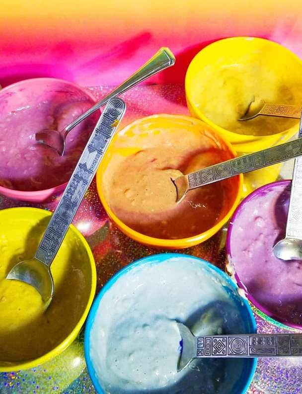 Bowls of the pancake mix with natural food color added
