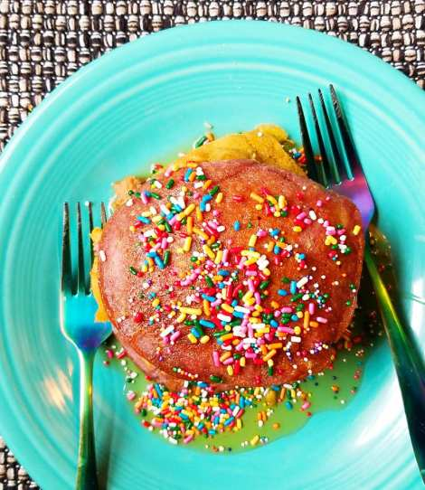 Stack of Enjoy Life Foods natural color pancakes with rainbow sprinkles