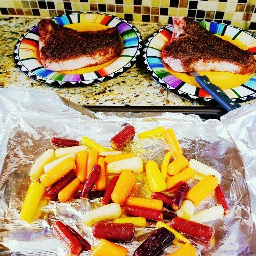 T-bone steak with coffee cardamom rub and mini rainbow carrots with cardamom ghee