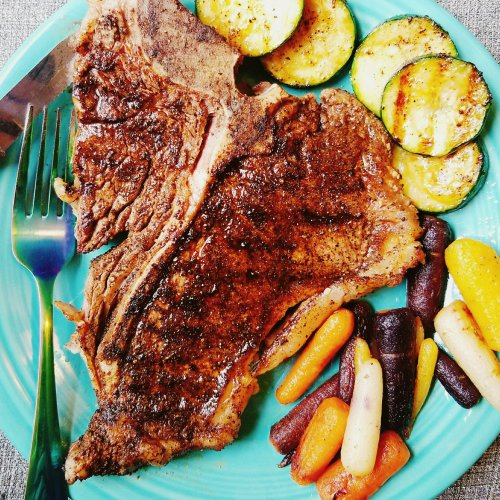 Coffee and cardamom t-bone steak with cardamom carrots and zucchini