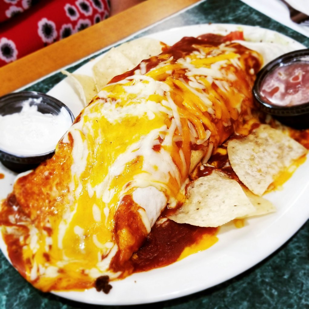 Check out my mom's GIGANTIC burrito at Tony's I-75 restaurant!! HUGE!!!!!