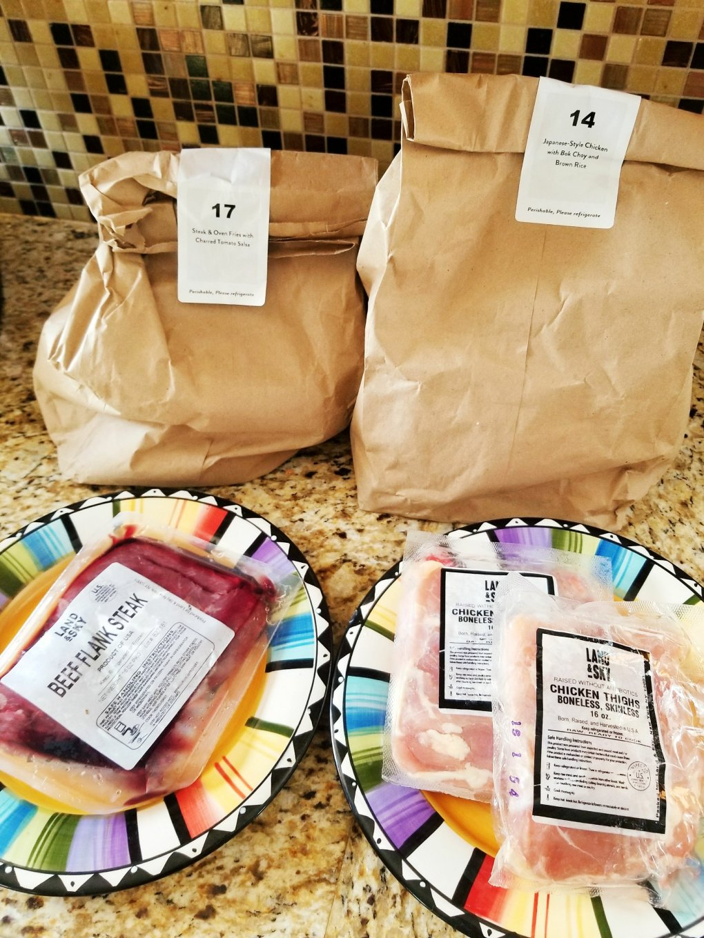 Two Marley Spoon Meal Kits for four people: Steak & Oven Fries w/ Charred Tomato Salsa and Japanese Style Chicken w./ Bok Choy and Brown Rice